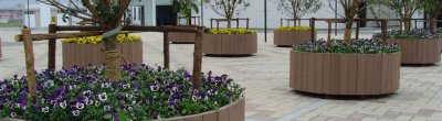 The advantages of wood plastic composite flower stand in garden landscaping